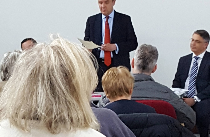 Greg Hands MP addressing his open meeting against Heathrow expansion in Fulham Library, with speakers from Heathrow Airport and NATS.