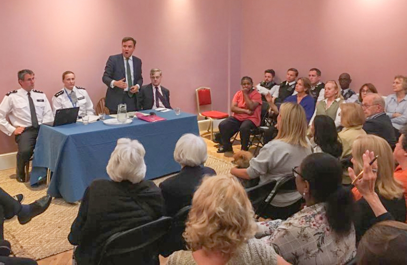 Greg Hands addressing a recent public meeting on crime in Chelsea